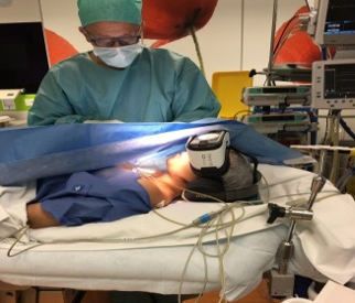 Dr Hervé Rosay doing a surgery on a patient experimenting Digital Sedation