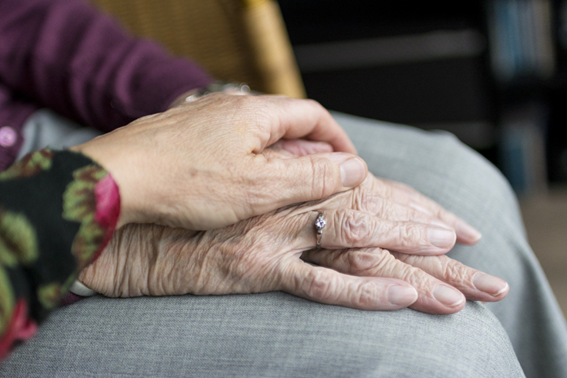 Picture to describe the paragraph.  Picture of a hand holding an elder woman's hand to illustrate support.